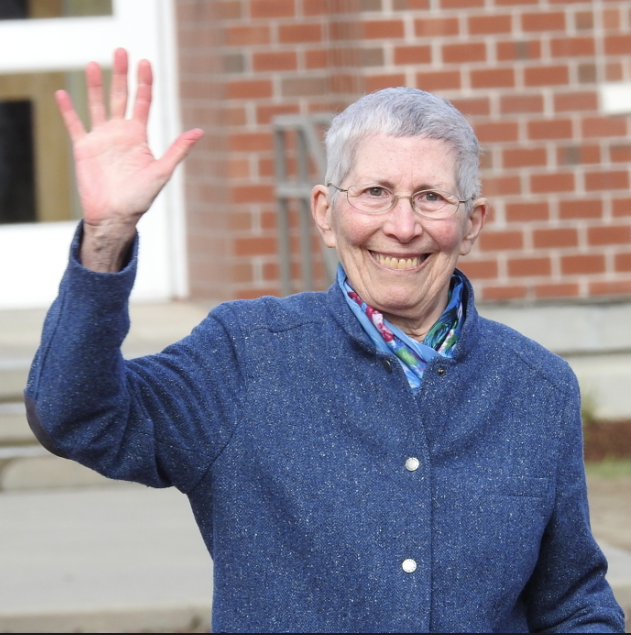 Theodora J. Kalikow waves to the crowd attending a dedication to name the education center after her.