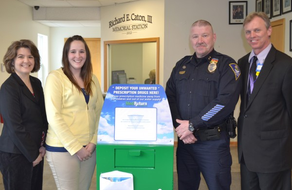 Left to right: Nicole Ditata, HMP director; Christine Bruen, HCC program associate; Jack Peck, Farmington police chief; and Greg Patterson, Wal-Mart store manager.