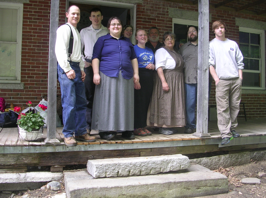 Maranacook Community High School Students and their teachers on the porch at Ambleside, together with living history specialists Corey Ellis & Deb Frino. Ellis is at the left and Deb Frino is third from the right.