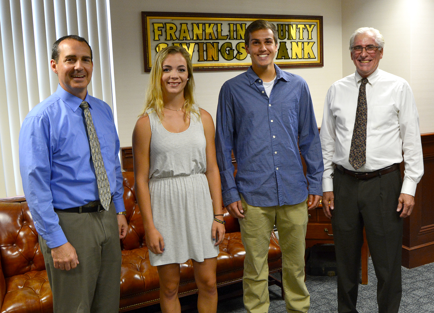 Mt. Blue High School graduates Caitlin Kane and Alexander Bunnell, flanked by FSB Executive Vice President Tim Thompson and President Peter Judkins.
