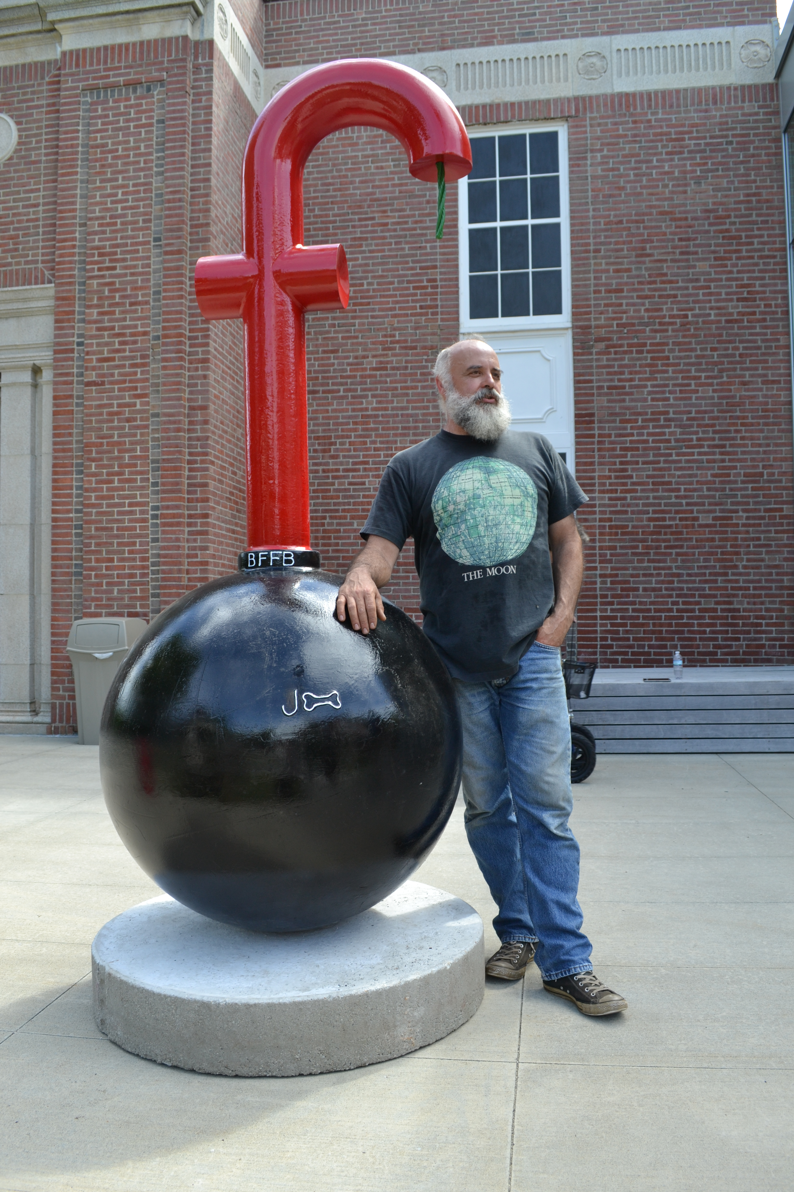 J Bone Sawyer stands with the F-Bomb sculpture.