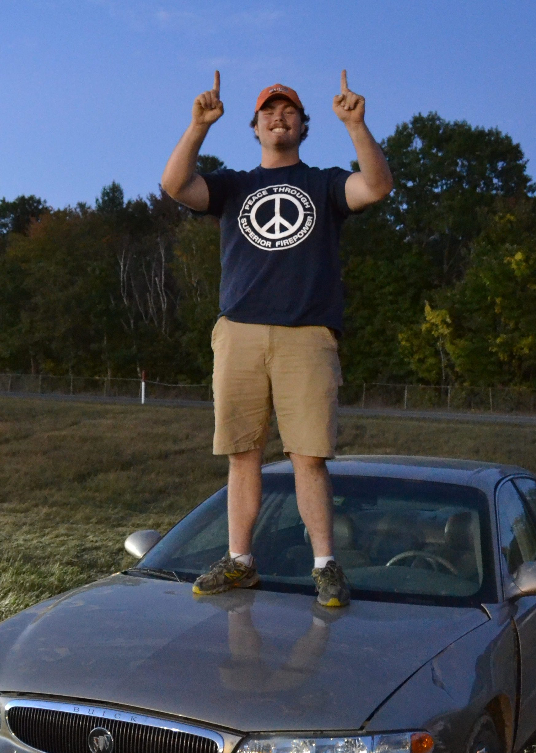 Caleb Walters stands on his winning Buick.