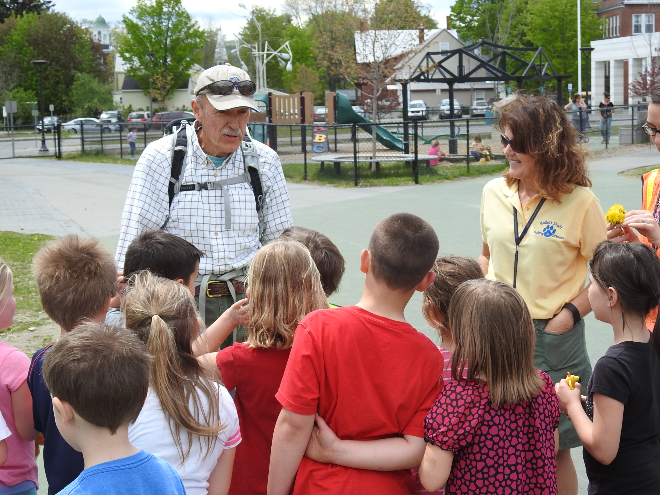 Doug Dunlap meets with Mallett School students and Principal Tracy Williams in May, prior to his hike.