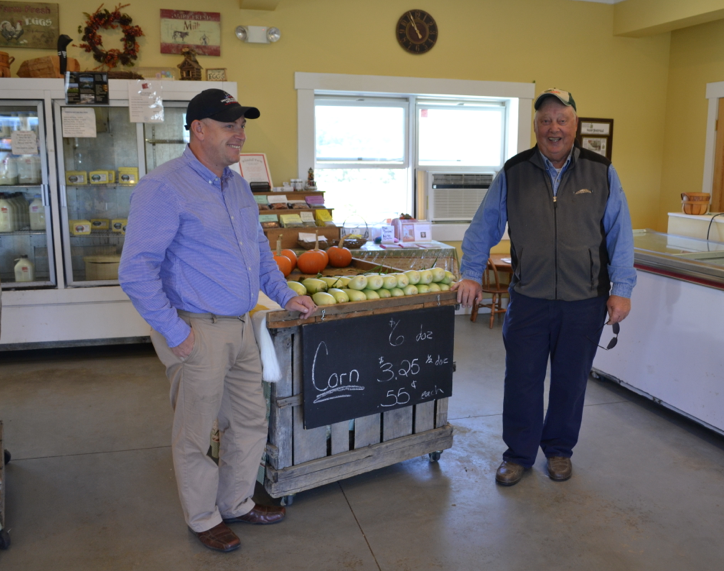 Jerry Ireland of United Farmer Veterans of America stands with Bussie York in his farm store.