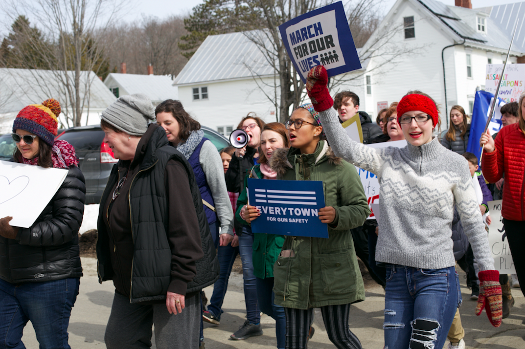 Students from Mt. Blue High School march in downtown Farmington on Saturday